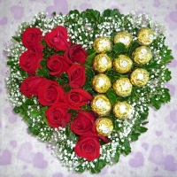 Heart Shape Arrangement of roses 24 roses and 24 ferrero..